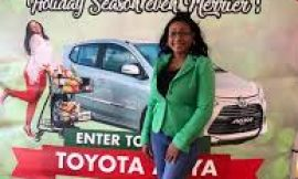 Winner of RAMS Christmas Car Promotion is Ms. Tamiko Kelly