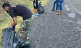 Nevis Division of the Police Force conducts mass cleanup of Long Point Road